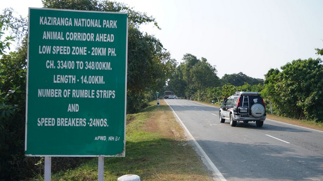 A signboard on NH-37 in Kaziranga warning about animal corridors and speed limit